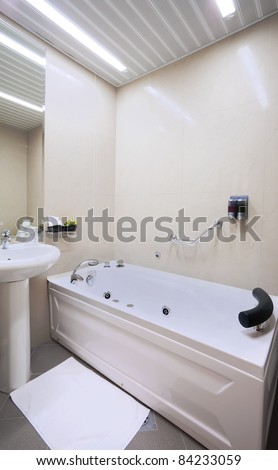 Interior of a hotel bathroom in white.