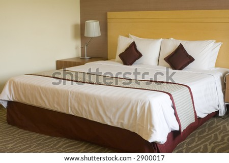Interior of a hotel room showing a king sized bed - stock photo
