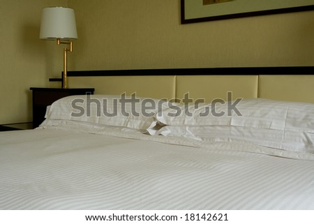 Interior of a hotel suite room showing a king sized bed - stock photo