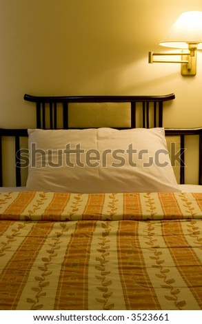 Interior of a hotel suite room showing a single bed - stock photo