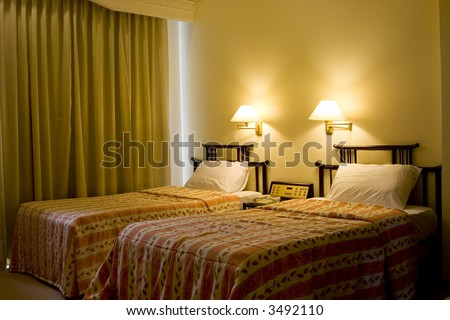 Interior of a hotel suite room showing two single bed