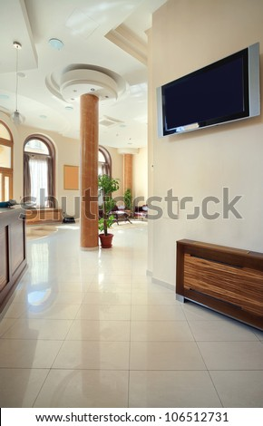 Interior of a hotel, view on reception and waiting room.