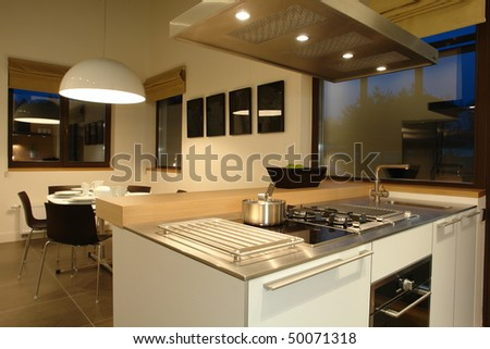 interior of a kitchen and dinning room - stock photo
