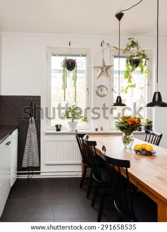 interior of a kitchen black floor - stock photo