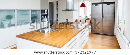 interior of a kitchen with a kitchen island - stock photo
