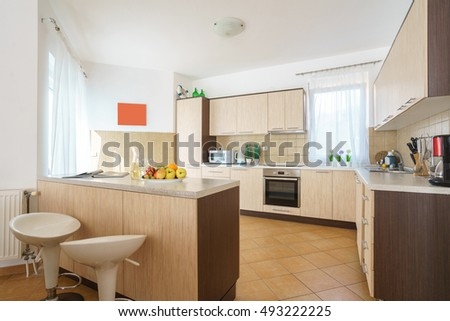 Interior of a kitchen with bar counter in a villa