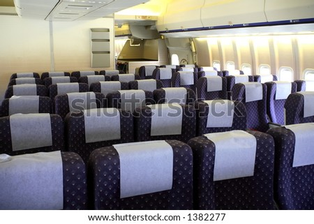 Interior of a large passenger aircraft. - stock photo