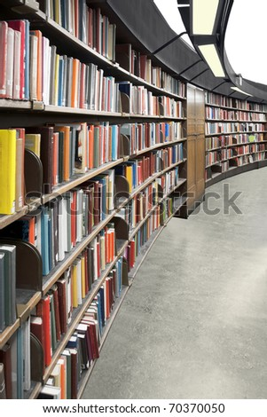 Interior of a library with book shelves - stock photo