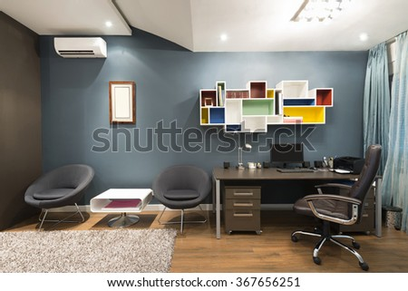 Interior of a loft apartment study room - stock photo