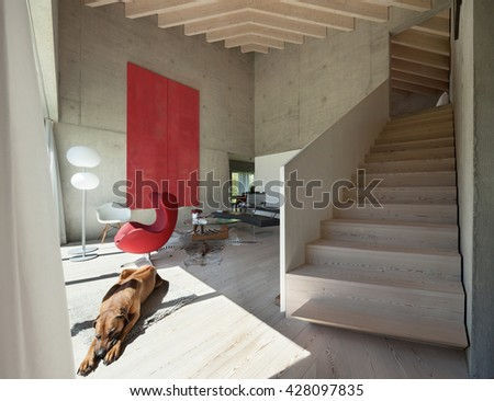 Interior of a loft, modern living room with red armchair, concrete walls - stock photo