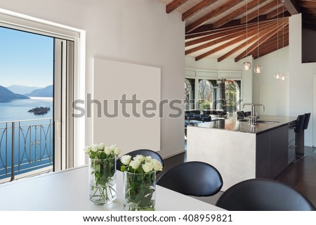 Interior of a loft, wide open space, dining table modern design - stock photo