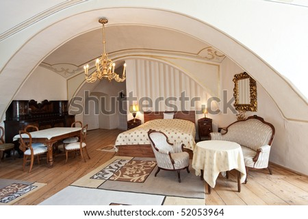 interior of a luxurious old style hotel room - stock photo