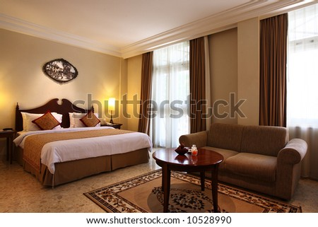 Interior of a luxury hotel bedroom - stock photo