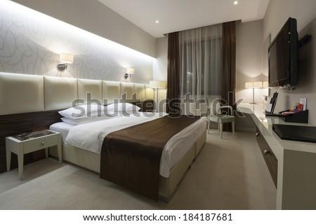 Interior of a luxury hotel bedroom in night  - stock photo