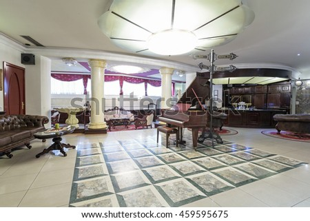 Interior of a luxury hotel lobby with piano