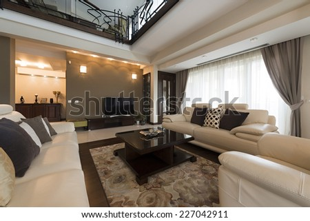 Interior of a luxury spacious living room - stock photo