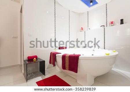 Interior of a luxury white bathroom with jacuzzi bath - stock photo
