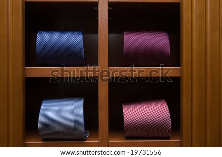 Interior of a mens wear store, business clothing - necktie - stock photo