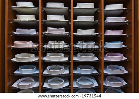 Interior of a mens wear store, business clothing - shirts - stock photo