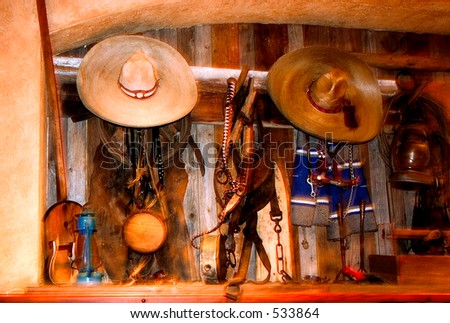 interior of a mexican restaurant,  hats, musical instruments, old lamps e.t.c. - stock photo