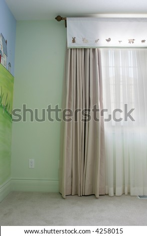 Interior of a model home showing drapery using wrought iron, side panels and sheers - stock photo
