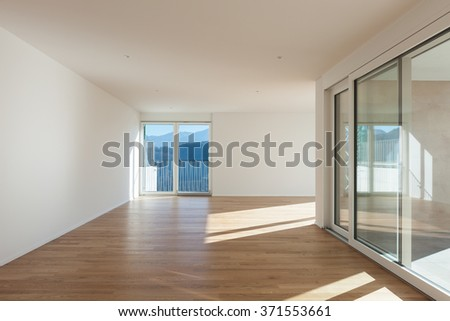 interior of a modern apartment, empty open space, hardwood floor