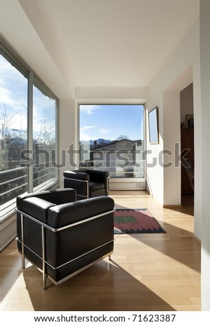 interior of a modern apartment, room with panoramic window
