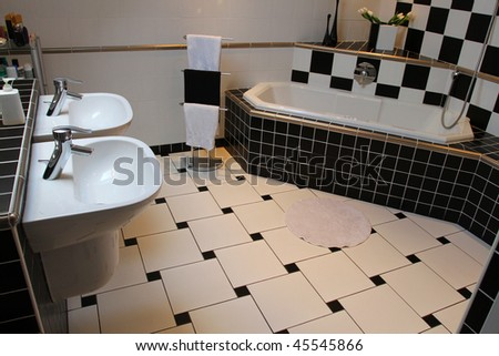 Interior of a modern bathroom. Black and white tiling - stock photo