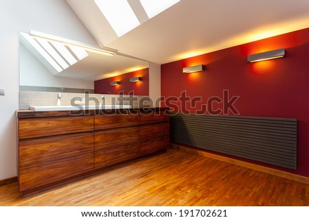 Interior of a modern bathroom with wooden elements - stock photo