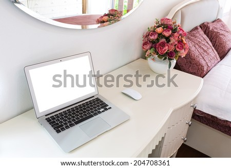 Interior of a modern bed room with laptop computer - stock photo