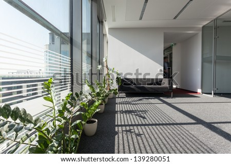 Interior of a modern building with grey sofa - stock photo
