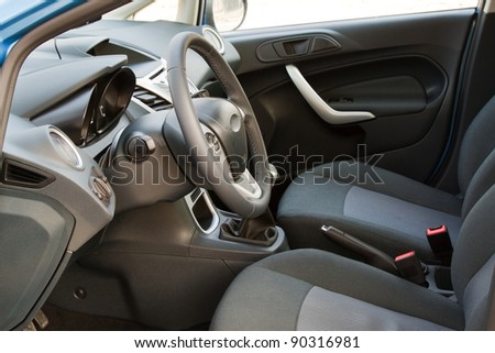 Interior of a modern car, front seats - stock photo
