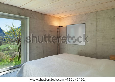 Interior of a modern chalet in cement, bedroom - stock photo