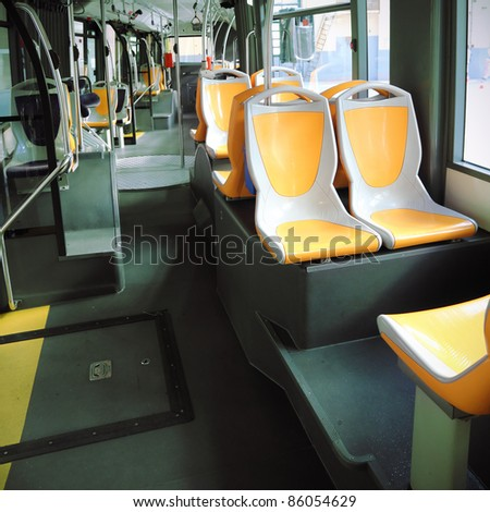 Interior of a modern empty city bus - stock photo
