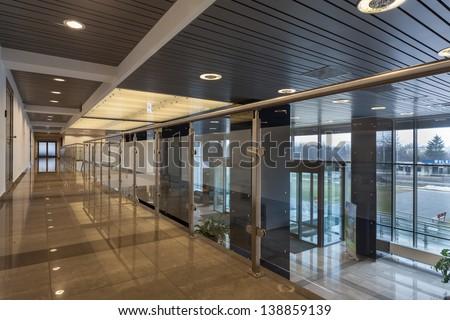 Interior of a modern futuristic office building - stock photo