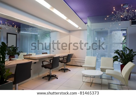 Interior of a modern hair salon - stock photo