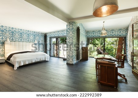 interior of a modern house, beautiful bedroom, double bed - stock photo