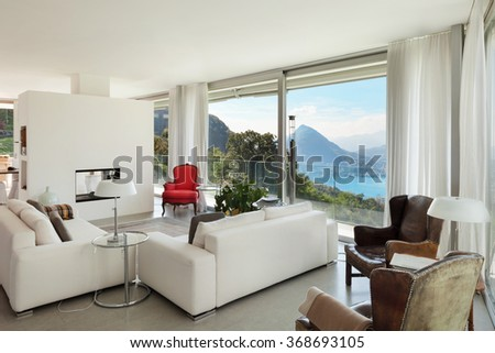 Interior of a modern house, comfortable living room - stock photo