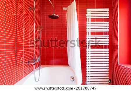 interior of a modern house, red bathroom - stock photo