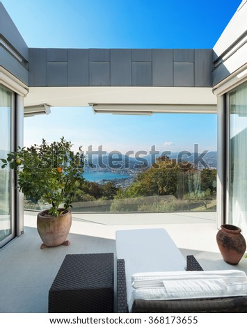 Interior of a modern house,� veranda overlooking the lake