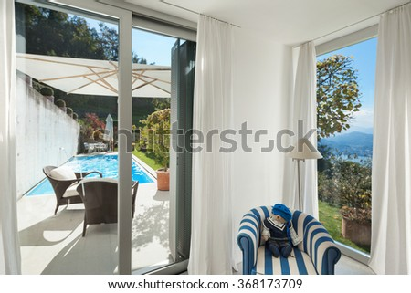 Interior of a modern house,� window with access to the pool - stock photo