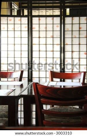 Interior of a modern japanese restaurant with rice paper screen - stock photo