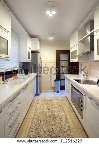 Interior of a modern kitchen during day. - stock photo