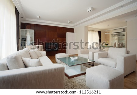 Interior of a modern living room in white. - stock photo