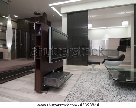 interior of a modern living room with a view to a kitchen - stock photo