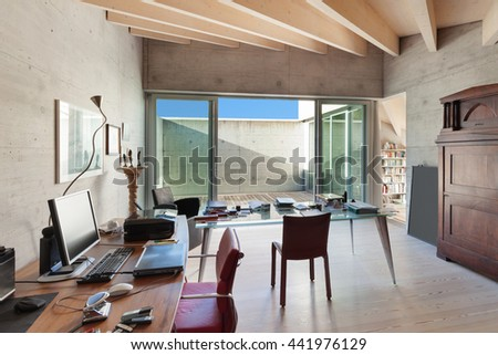 Interior of a modern loft, room with desks, concrete walls