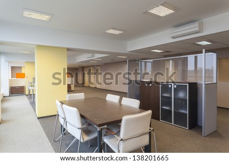 Interior of a modern office building, empty room - stock photo