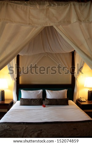 Interior of a modern resort bedroom - travel and tourism. - stock photo