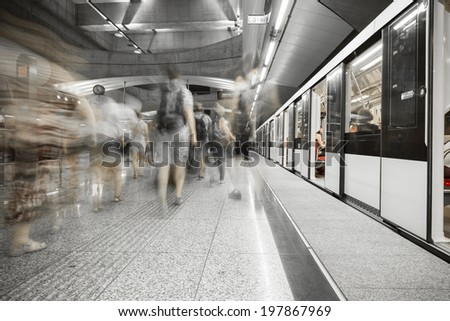 Interior of a modern subway station,  blurred people - stock photo