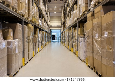 Interior of a modern warehouse full of a products - stock photo